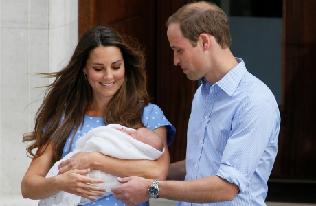 Britain's Prince William, right, and Kate, Duchess of Cambridge hold the Prince of Cambridge, Tuesday July 23, 2013, as they pose for the media outside St. Mary's Hospital's exclusive Lindo Wing in London where the Duchess gave birth on Monday July 22. The boy, who is third in line to the British throne, has since been named George Alexander Louis by his parents and will be known as Prince George of Cambridge. (AP Photo/Kirsty Wigglesworth)