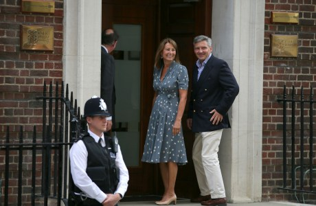 Carole and Michael Middleton arrive at St. Mary's Hospital to visit their daughter, Catherine, Duchess of Cambridge, Prince William, and the newborn royal baby. (AP Photo/Alastair Grant)