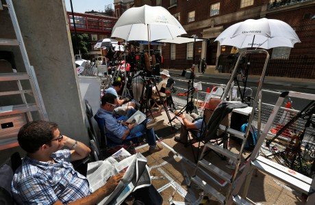 Members of the media sit outside the Lindo Wing of St. Mary's Hospital, awaiting the birth of the royal child. (AP Photo/Lefteris Pitarakis)