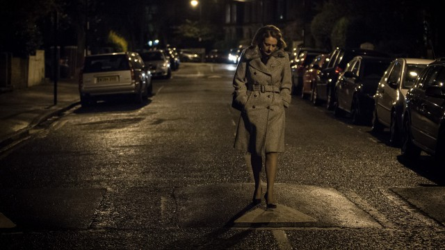 Emily Hammond (Rachel Hankey) walking along London's dark streets.