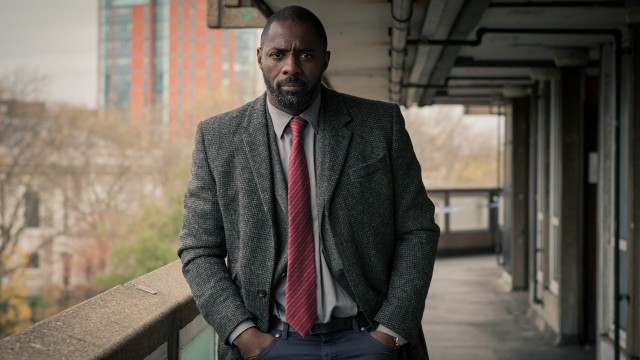 DCI Luther walks with determination.