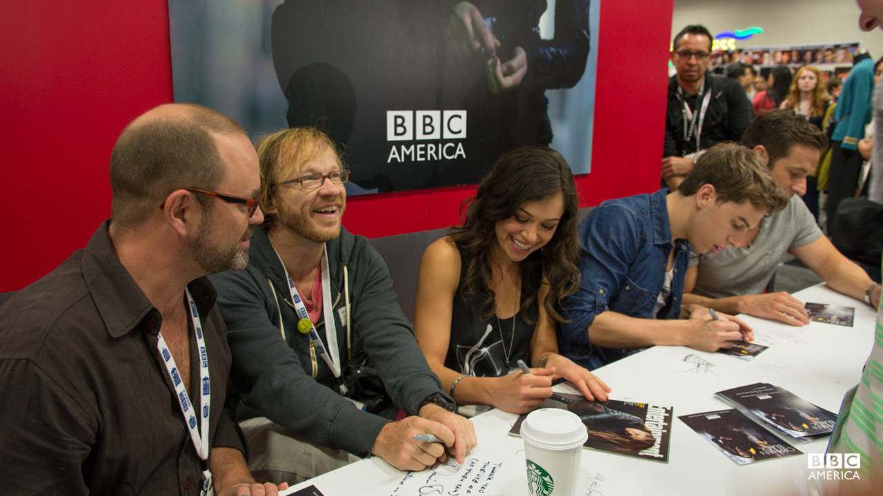 "Graeme Mason, John Fawcett, Tatiana Maslany, Jordan Gavaris and Dylan Bruce sign autographs for ""Orphan Black"" fans."