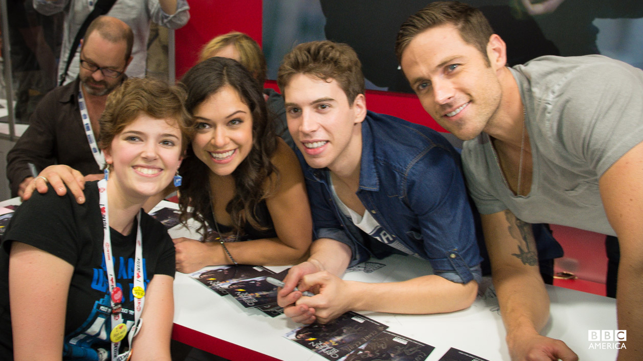 Tatiana Maslany, Jordan Gavaris and Dylan Bruce with a fan.