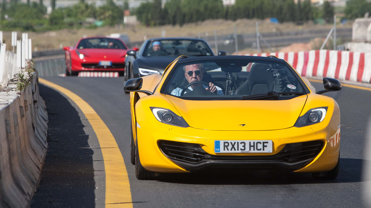 Jeremy Clarkson driving the McLaren MP4-12C Spider followed by James May in the Audi R8 Spyder and Richard Hammon in the Ferrari 458 Spider