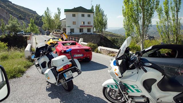 Ferrari 458 Spider and McLaren MP4-12C Spider driving through Spain