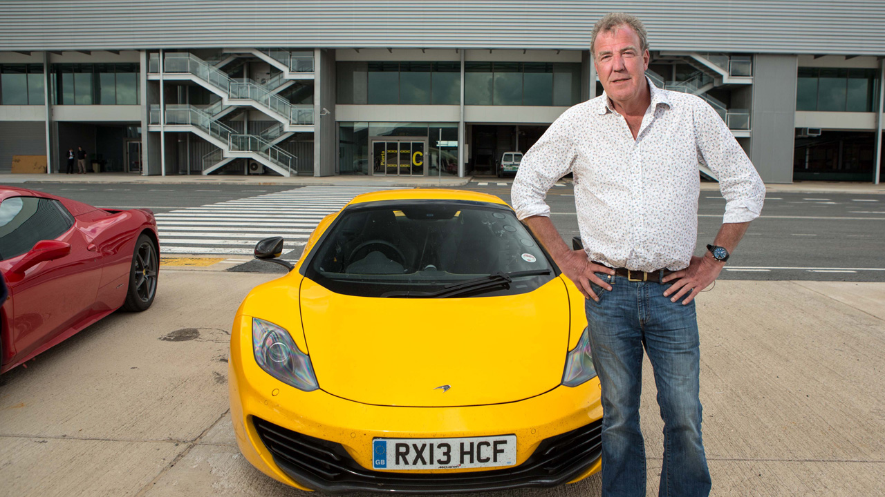 Jeremy Clarkson and the McLaren MP2 at a deserted airport in Spain
