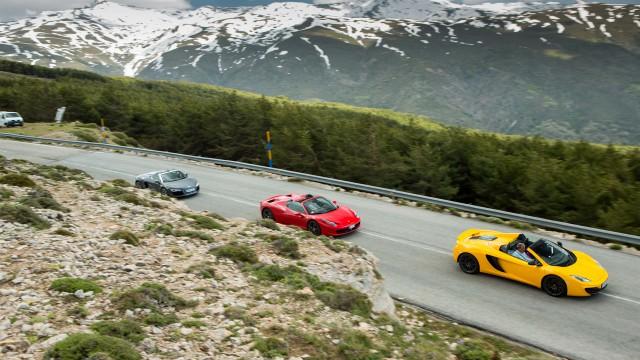 Audi R8 Spyder, Ferrari 458 Spider and McLaren MP4-12C Spider driving through Spain