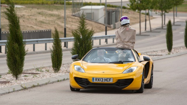 Jeremy Clarkson driving a McLaren MP4-12C Spider with a parcel wrapped Stig in Valdeluz, Spain