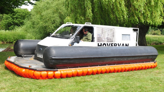 James May, Richard Hammond and Jeremy Clarkson in the Hovervan on the banks of the river Avon