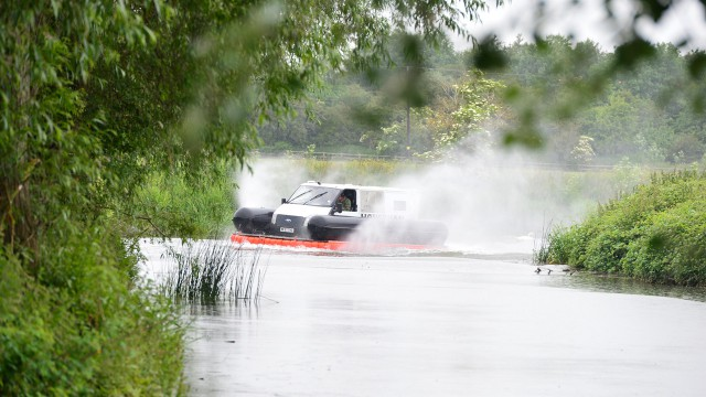 James May, Richard Hammond and Jeremy Clarkson driving the Hovervan on the River Avon