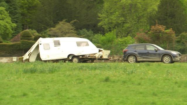 Mazda CX5 towing a wrecked caravan