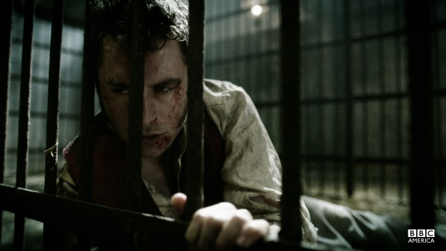 Maguire is left beaten in a jail cell.