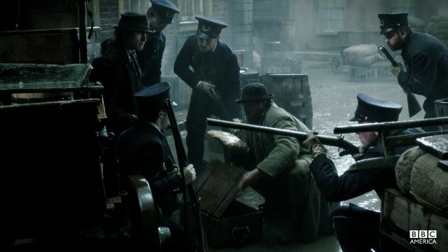 Detective Corcoran readies his men to storm the police station.