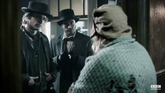 The detectives talk to another tenant in the building.