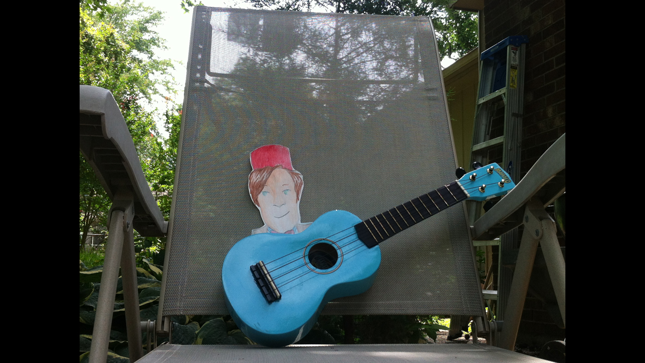 Chillin' on the patio, strummin' the uke, in our backyard in Cape Girardeau, Missouri. - Kristi V. *Finalist*