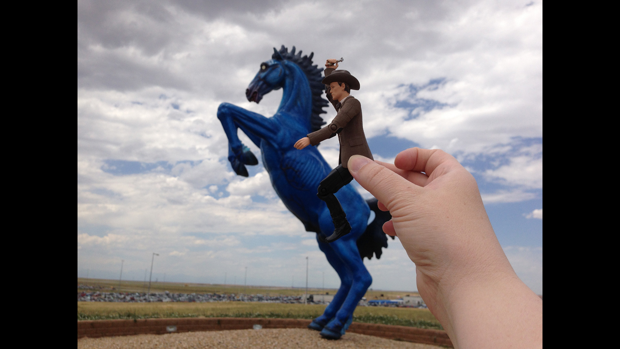 Riding the Denver Demon Horse outside Denver International Airport! - Shelley D. **GRAND PRIZE WINNER**