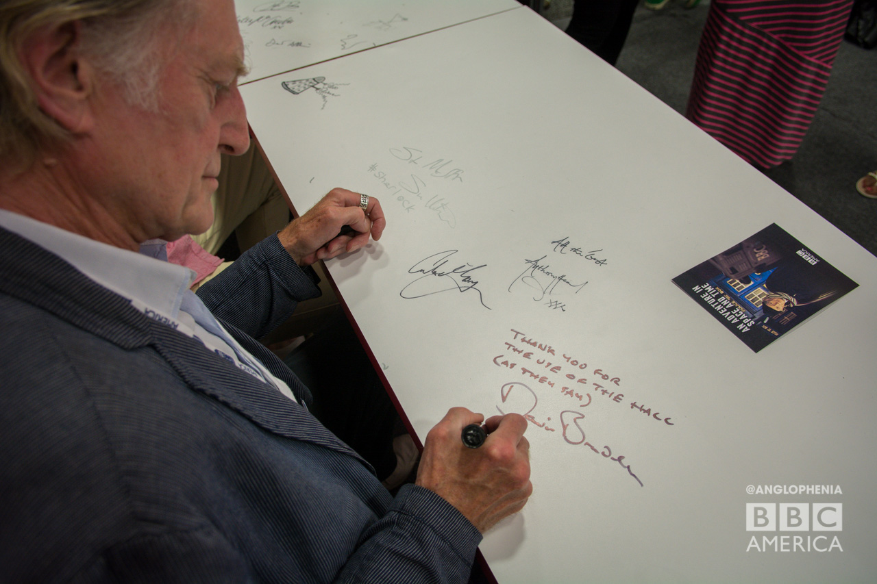 David Bradley leaves a message on the table at BBC AMERICA's booth. (Photo: Dave Gustav Anderson)