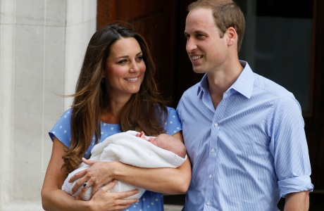 Britain's Prince William, right, and Kate, Duchess of Cambridge hold the Prince of Cambridge, Tuesday July 23, 2013, as they pose for photographers outside St. Mary's Hospital exclusive Lindo Wing in London where the Duchess gave birth on Monday July 22. The boy, who is third in line to the British throne, has since been named George Alexander Louis by his parents and will be known as Prince George of Cambridge. (AP Photo/Kirsty Wigglesworth)