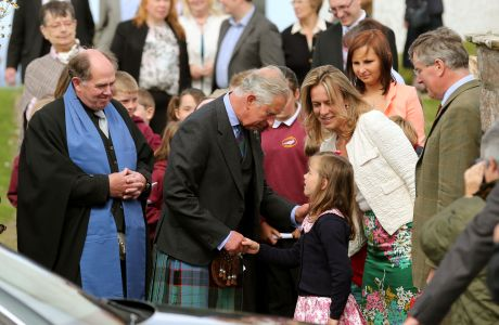 Royal visit to Scotland. The Prince of Wales with minister Mr Lyall Rennie (left) greeting members of the congregation at a church service at Canisbay Church, Caithness. Picture date: Sunday August 4, 2013. Photo credit should read: Andrew Milligan/PA Wire URN:17235402 (Press Association via AP Images)