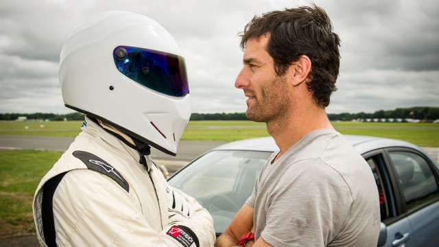 Mark Webber and The Stig face off.