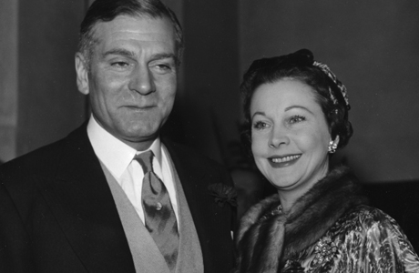 Indian born, British actress Vivien Leigh arrives with her husband actor Sir Laurence Oliver, at the Holy Trinity church in London, England, December 6, 1957, to attend the wedding of Suzanne Holman, Miss Leigh's daughter by her first marriage to Robin Farrington, member of Lloyd's underwriting firm. Miss Holeman's father, Leigh Holman, gave the bride away. (AP Photo)