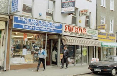 Shops and stores on Brick Lane in London are shown, 1989. (AP Photo/Peter Kemp)