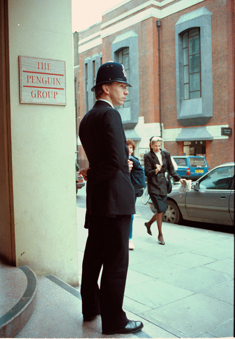 "A policeman stands outside the London headquarters of the Penguin Group, publisher of Salman Rushdie's controversial novel ""The Satanic Verses,"" Feb. 15, 1989.  Iran's Ayatollah Khomeini has issued a fatwa against Rushdie, telling Muslims to kill the author for blaspheming against Islam.  (AP Photo/Tony White)"