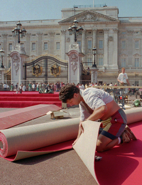 A carpet-layer cuts out the red carpet, 1995. (AP)