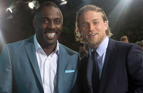 'Pacific Rim' stars Idris Elba and Charlie Hunnam are British success stories in Hollywood. (Photo: Joel Ryan/Invision/AP)