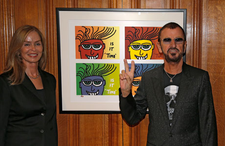 Ringo Starr and Barbara Bach in front of one of Ringo's paintings (AP Images)