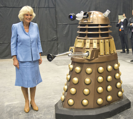 Camilla, Duchess of Cornwall, keeps a safe distance from the Dalek. (AP)