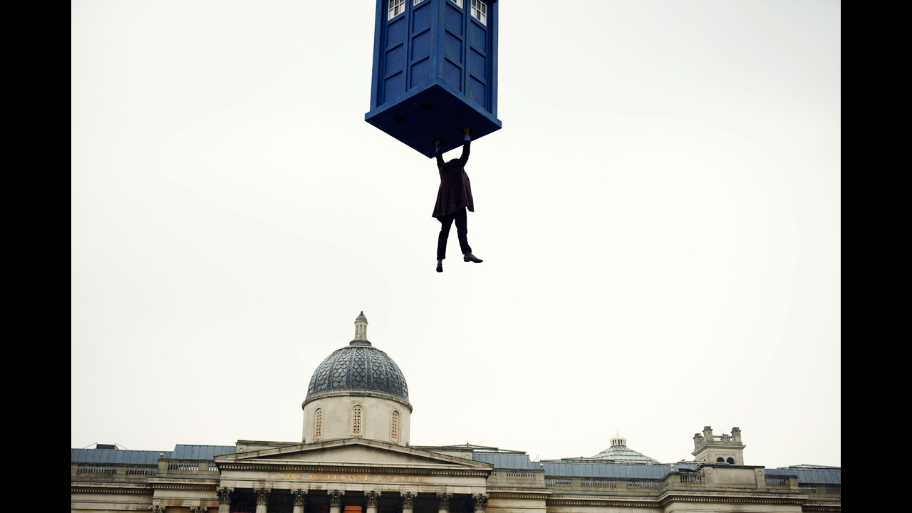 The Doctor dangles from the TARDIS above London's National Gallery.