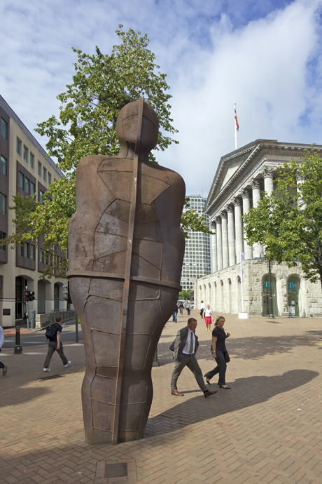 Pedestrians pass the Iron Man sculpture by Antony Gormley 1993 (Peter Barritt/Robert Harding /AP Images)