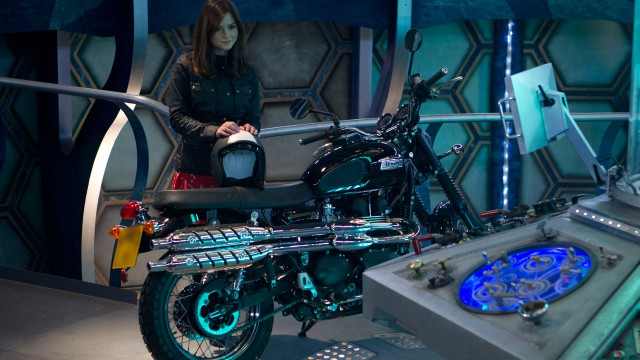 Jenna Coleman as Clara with a motorcycle in the TARDIS.