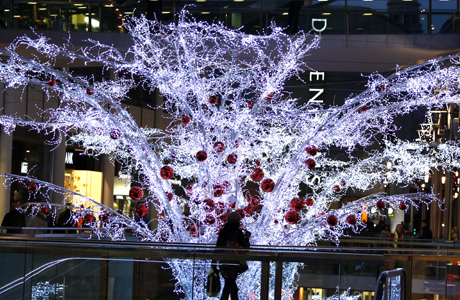 Christmas lights in Liverpool. A shopper passes the Christmas lights at Liverpool 1 in Liverpool City Centre. Issue date: Wednesday November 27, 2013. Photo credit should read: Peter Byrne/PA Wire URN:18329850