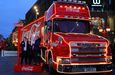 Christmas lights in Liverpool. Shoppers pass the Christmas lights and the Coca-Cola truck at Liverpool 1 in Liverpool City Centre. Issue date: Wednesday November 27, 2013. Photo credit should read: Peter Byrne/PA Wire URN:18329871