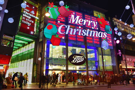 Merry Christmas sign on Boots shop as part of the Oxford Street Christmas Lights and Xmas Decorations Oxford Street Christmas Lights, London, Britain - 12 Nov 2013  (Rex Features via AP Images)