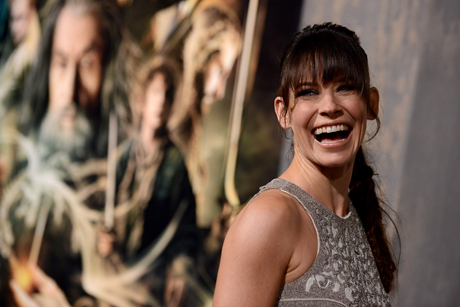 It's not all boys ... Evangeline Lilly (Tauriel) steps onto the black carpet. (Jordan Strauss/Invision/AP)