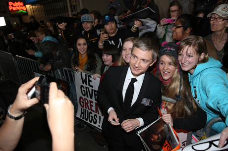 Martin Freeman stopped to take some snaps with his adoring fans. Notice the fan in the background! (Jordan Strauss/Invision/AP)