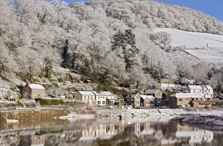 River and village in snow, Tintern, River Wye, Wye Valley, Monmouthshire, Wales, winter (Photo by: Minden Pictures/AP Images)