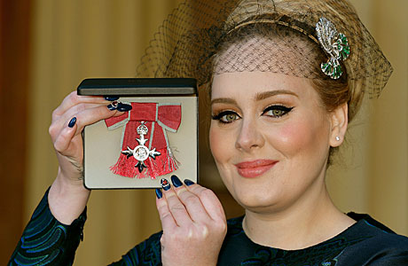 Adele gets her MBE (AP Images)