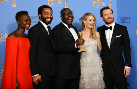 From left: Lupita Nyong'o, Chiwetel Ejiofor, Steve McQueen, Sarah Paulson, and Michael Fassbender backstage after '12 Years a Slave' won the Golden Globe for Best Motion Picture, Drama. (Photo: Jordan Strauss/Invision/AP)