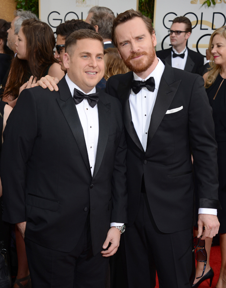 Jonah Hill and Michael Fassbender on the Golden Globes red carpet. (Photo by Jordan Strauss/Invision/AP)