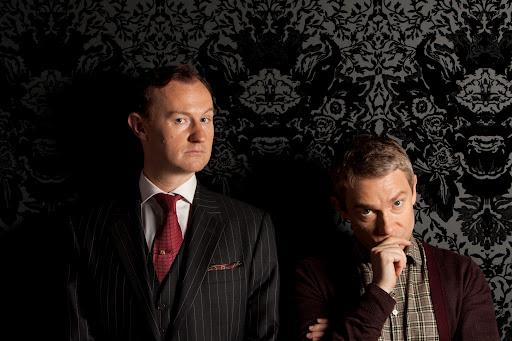 Mark Gatiss and Martin Freeman hold up the wallpaper. (ITV)