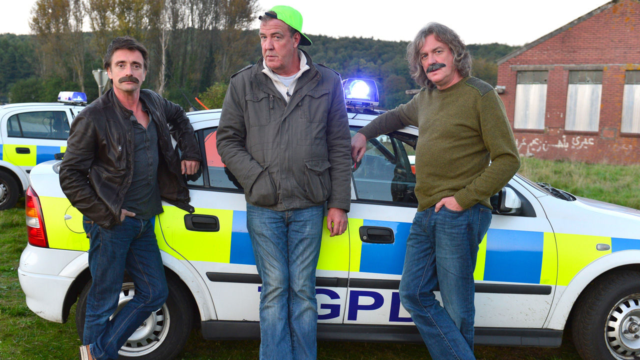 Richard Hammond, Jeremy Clarkson and James May with the Top Gear Police Department Vauxhall Astra.