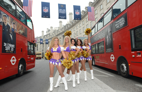 NFL cheerleaders on Regent Street between two double-decker buses. (Photo: AP/NFL, Dave Shopland)