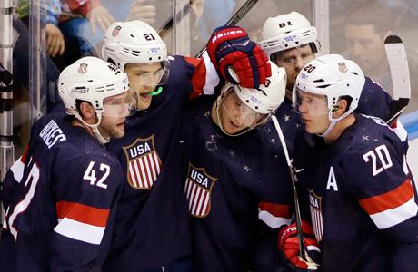 Team USA celebrating during the men's hockey game against Russia. (Photo: David J. Phillip/AP)