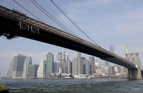 The Brooklyn Bridge provides a convenient way to get to Brooklyn from Manhattan. (AP Photo/Seth Wenig)