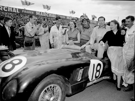 Duncan Hamilton, centre, poses alongside his co-driver Tony Rolt and their wives, in their winning Jaguar, after winning the Le Mans 24 race, June 15,1953. The race gave Britain first, second and fourth places with Jaguar cars, with the winning car being driven by Duncan Hamilton and Tony Rolt at a new record average speed of 105.6 MPH. They covered 2,540 miles in the 24 hours. Only 26 cars finished the race out of 60 starters, watched by a crowd of 800,000, around an eight mile circuit. (AP Photo)