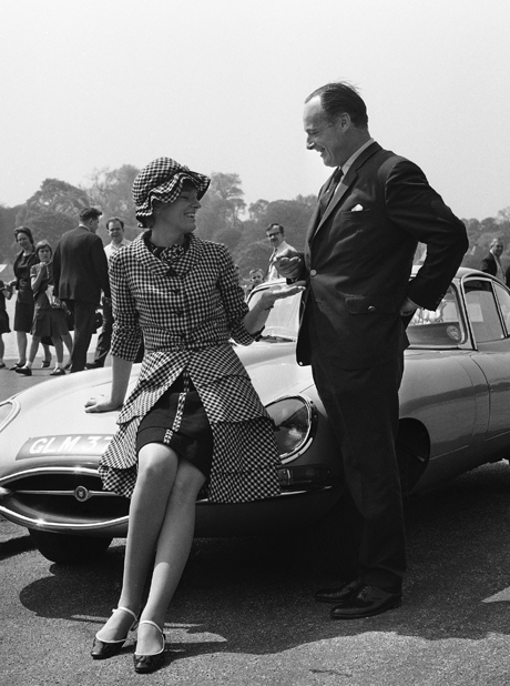 World land and water speed record holder, Donald Campbell, hands over to his wife, Tonia Bern, the keys of the E type Jaguar car she is using as a seat, beside the Serpentine in London's Hyde Park, England on May 1, 1966, to mark the opening of her season of cabaret at the Pigalle restaurant. (AP Photo/Kemp)